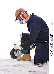 workman with angle grinder wearing full protective clothing