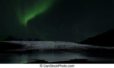 Northern Lights over glacier in Iceland. This time lapse...