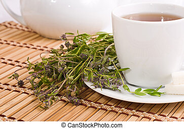 cup of herbal tea and teapot - the cup of herbal tea with...
