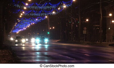Christmas street lights and night traffic in Romania