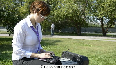 Business lady typing on laptop