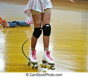 Young Girl Roller Skating with Knee Pads - This is a young...