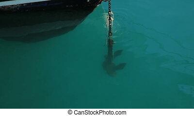 Anchor dropping into sea