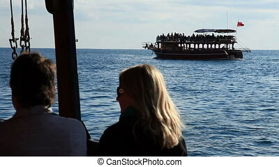 Sea trip editorial - Tourist couple doing romantic sea trip...