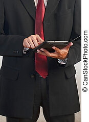 Businessman using a tablet computer - Businessman...