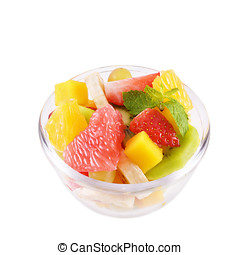 Fruit salad - Glass bowl with mixed fruit salad over white...