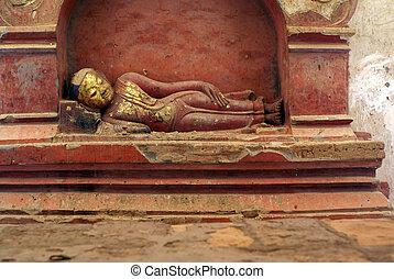 Red sleeping Buddha in Dhammayan Gyi temple in Bagan,...