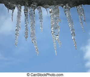 icicles heap on blue sky, winter environment