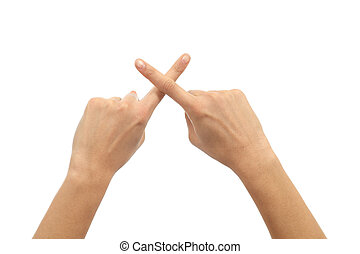 Woman hands crossing fingers on a white isolated background...
