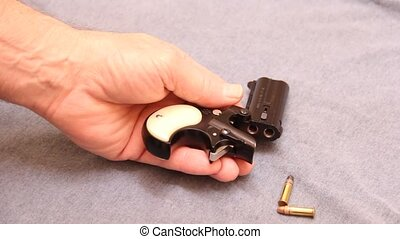 loading a derringer - loading a small derringer pistol
