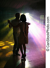 First dance - Dancing pair on a background of rays of light