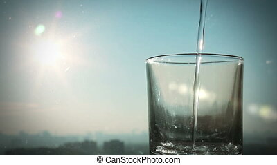 pouring water - conceptual footage of pouring water on a...