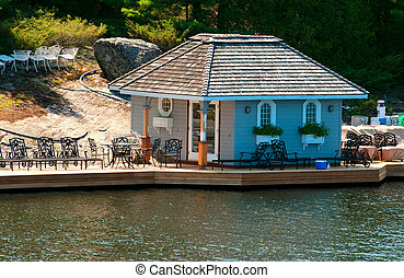Dock with a small cottage