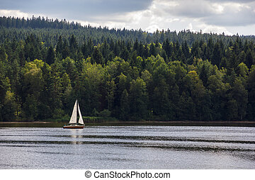 Sailboat on lake. - Sailboat on Lipno lake, Czech Republic.
