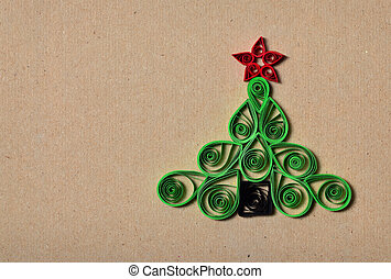 Handmade Christmas tree cut out from paper. Quilling.