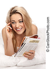 Beautiful woman listening to a call on her mobile