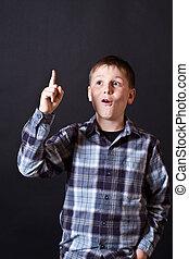 Teen boy showing thumb up