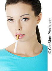 Young woman with cigarette in her mouth.