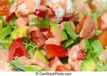 Shrimp salad with avocado close up
