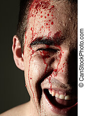 Close up of laughing man face in blood - Close up of...