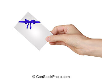 Hand holding gift card with blue ribbon and beautiful bow isolated on white background