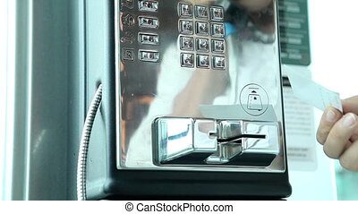 call by pay telephone - somebody%u2019s hand dials on public...