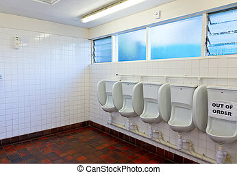 Public toilet interior - Empty public lavatory with urinal...