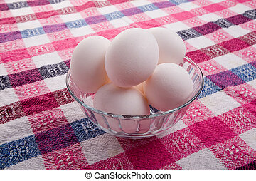 Eggs - White eggs in a glass bowl on a tablecloth