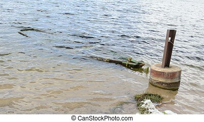 sunken boast wave lake - Sunken wooden row boat rowboat...