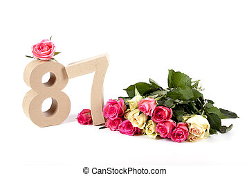 Age in figures on a bed of roses - Number of age in a...