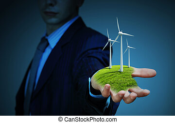 clean energy windmills - Business man and a windmills as a...