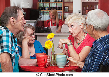 Mature Group of Friends Talking - Concerned woman conversing...