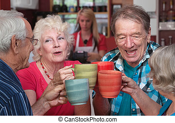 Group of Four Seniors Celebrating - Group of four happy...