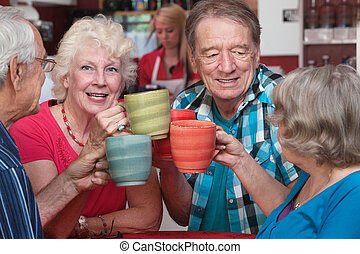 Smiling Woman Toasting with Friends - Smiling woman with...