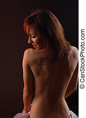 Naked young beautiful womans torso from behind - A beautiful...