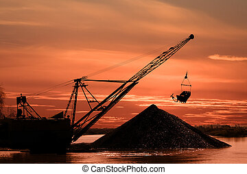 Career dredge - Silhouette of a career dredge on a...