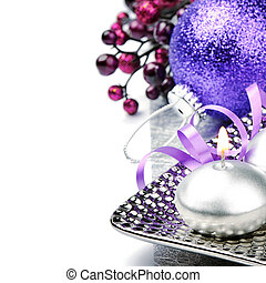 Festive candle and purple Christmas ball isolated over white