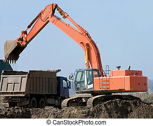 Dredge and the lorry on a background of the blue sky