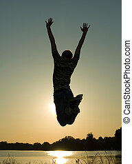 jump - Young guy in jump on background dark  sky