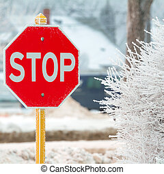 Stop sign - Stop road sign in snowy day in winter. Canada
