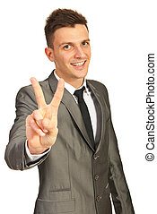 Executive showing victory sign - Happy executive man showing...