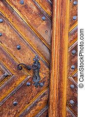 Ancient door handle. - Ancient door handle on old door in...