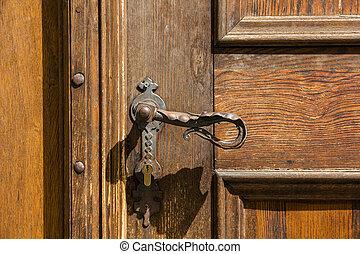 Ancient door handle - Ancient door handle on old door in...