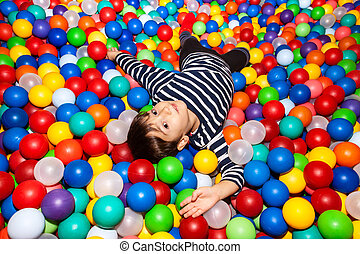 Boy playing with balls - Little boy playing with balls