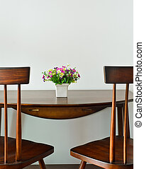 Small dining table with artificial flower pot