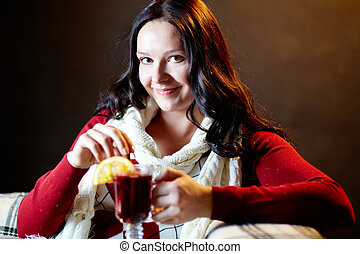 Warming up - Portrait of pretty female with tea looking at...