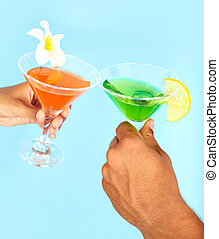 Cocktail party - Close-up of cocktails in human hands during...