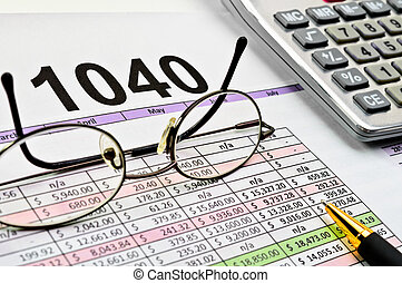 Tax forms with pen, calculator, pen and glasses.