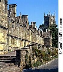 Almshouses, Chipping Campden, UK. - St. James Church Tower...