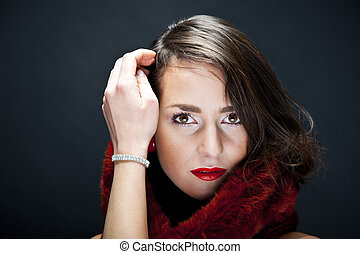 Beautiful woman on black background with jewelty